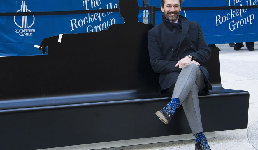"Jon Hamm appears at an unveiling of a bench dedicated to the ""Mad Men"" series in front of the Time & Life Building on Monday, March 23, 2015 in New York. The bench shows a silhouette of Hamm's character Don Draper. (Photo by Charles Sykes/Invision/AP)"