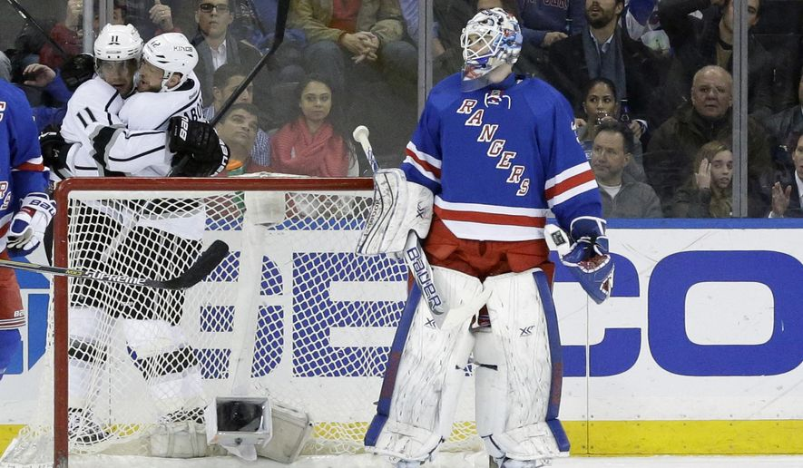 New York Rangers goalie Cam Talbot reacts as Los Angeles Kings right wing Marian Gaborik (12) and center Anze Kopitar (11) celebrate Gaborik's goal during the second period of an NHL hockey game, Tuesday, March 24, 2015, at Madison Square Garden in New York. (AP Photo/Mary Altaffer)