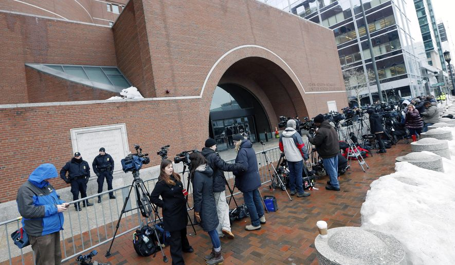 FILE--In this March 4, 2015 file photo, members of the media wait outside federal court in Boston on the first day of the federal death penalty trial of Boston Marathon bombing suspect Dzhokhar Tsarnaev. The crimes terrorized Boston, but with cameras banned from the federal courts, ordinary Bostonians have been denied the chance to see for themselves the 2013 trial of convicted mobster Whitey Bulger and ongoing trial of admitted Boston Marathon bomber Dzhokhar Tsarnaev. (AP Photo/Michael Dwyer, File)