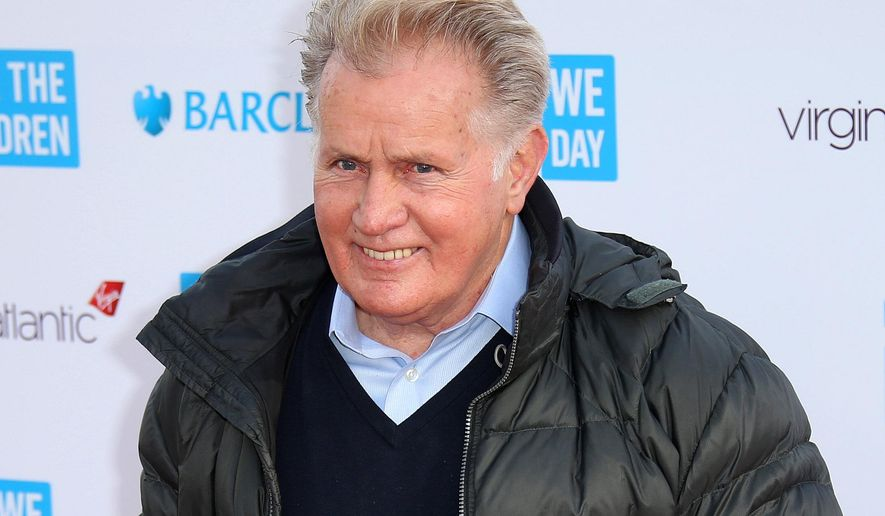 FILE - In this March 5, 2015 file photo, actor Martin Sheen poses for photographers on arrival at We Day UK at Wembley Arena, in west London. The University of Dayton will give actor Martin Sheen an honorary degree in recognition of his activism for peace, social justice and human rights. The school says the 74-year-old Sheen will receive an honorary doctor of humane letters degree at graduation ceremonies May 3 at the University of Dayton Arena. (Photo by Joel Ryan/Invision/AP, File)