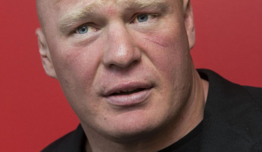"""Former UFC heavyweight champion Brock Lesnar pauses for a photo after ruling out a return to mixed martial arts, ending three years of speculation about the biggest pay-per-view star in the sport's history, as he announced he had re-signed with WWE in an interview on ESPN's """"SportsCenter,"""" in Los Angeles on Tuesday, March 24, 2015. Lesnar tells The Associated Press he was in training for a UFC return as recently as last week despite his conflicted feelings about it. He finally decided to stick with professional wrestling only in the past two days. (AP Photo/Damian Dovarganes)"""