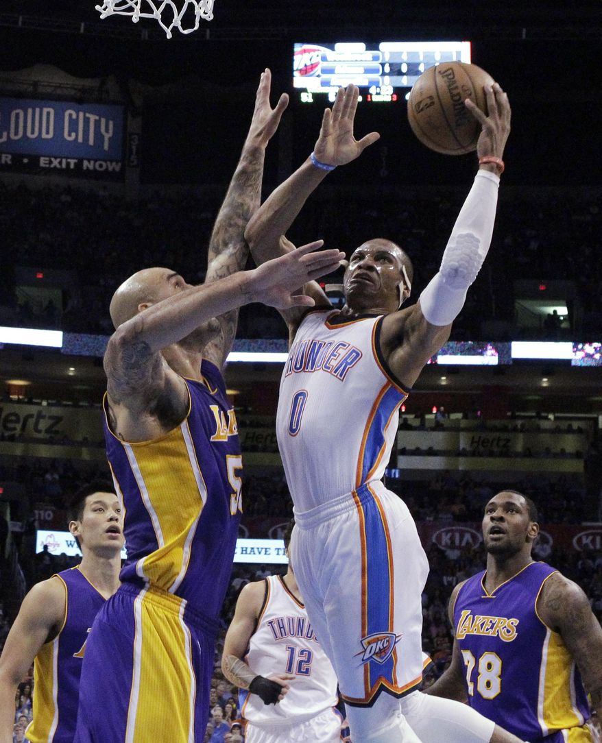 Oklahoma City Thunder guard Russell Westbrook (0) shoots as Los Angeles Lakers center Robert Sacre, left, defends during the second quarter of an NBA basketball game in Oklahoma City, Tuesday, March 24, 2015. (AP Photo/Sue Ogrocki)