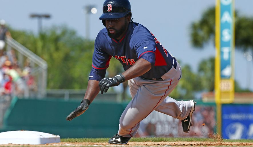 Boston Red Sox center fielder Jackie Bradley Jr. (25) dives back safely to first base in the seventh inning of an exhibition spring training baseball game against the Miami Marlins Tuesday, March 24, 2015, in Jupiter, Fla. (AP Photo/John Bazemore)