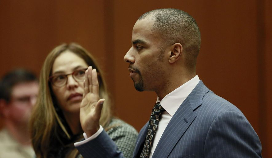 Former NFL safety Darren Sharper, right, appears in Los Angeles Superior Court on Monday, March 23, 2015. At left is his attorney, Lisa Wayne. Sharper pleaded no contest Monday in Los Angeles to charges of drugging and raping two women in the second of similar criminal cases in four states. Earlier, he pleaded guilty by video link to sexual assault in Arizona and was sentenced to nine years in federal prison. (AP Photo/Nick Ut, Pool)