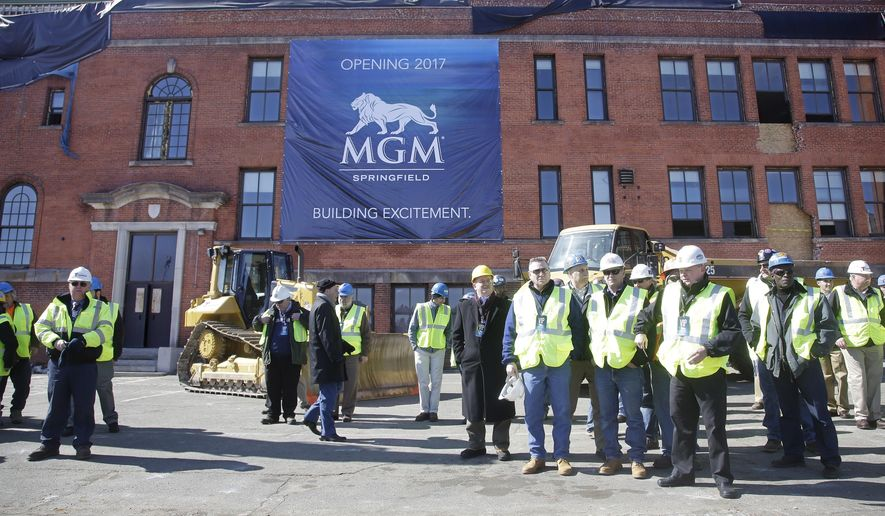 Constructions workers gather on the site to watch a ground breaking ceremony for the $800 million MGM casino resort scheduled to open in 2017, Tuesday, March 24, 2015, in Springfield, Mass., Tuesday, March 24, 2015, in Springfield, Mass. The casino resort, the largest economic development project the region has seen in generations, is scheduled to open in 2017. Springfield's MGM is the first of three casino resorts expected to open in the state. (AP Photo/Stephan Savoia)