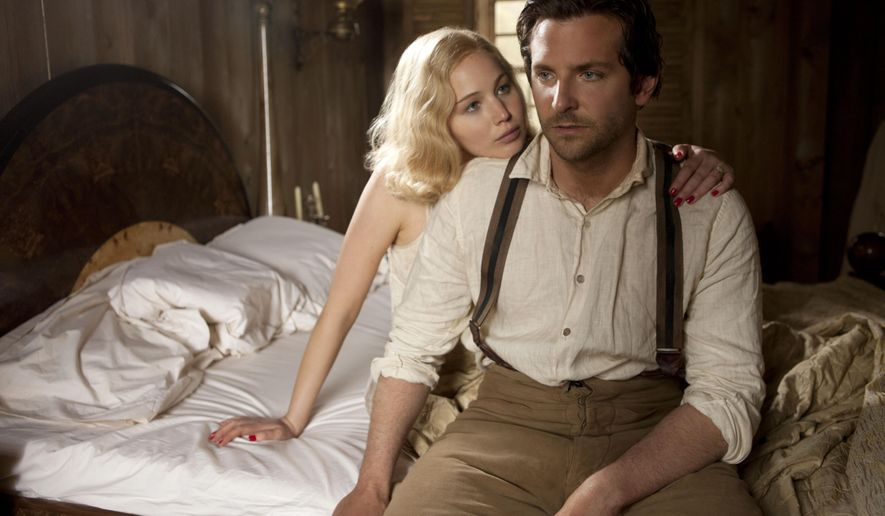 "In this image released by Magnolia Pictures, Jennifer Lawrence, left, and Bradley Cooper appear in a scene from ""Serena."" (AP Photo/Magnolia Pictures, Larry D. Horricks)"