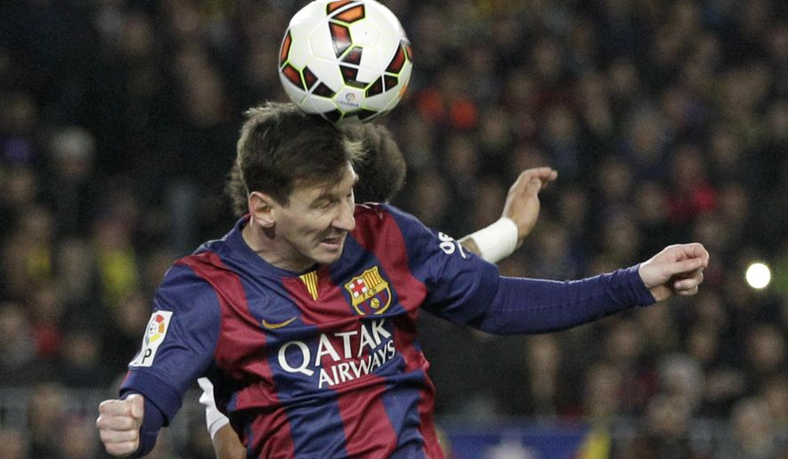 Barcelona's Lionel Messi heads the ball during a Spanish La Liga soccer match between FC Barcelona and Real Madrid at Camp Nou stadium, in Barcelona, Spain, Sunday, March 22, 2015. (AP Photo/Emilio Morenatti)