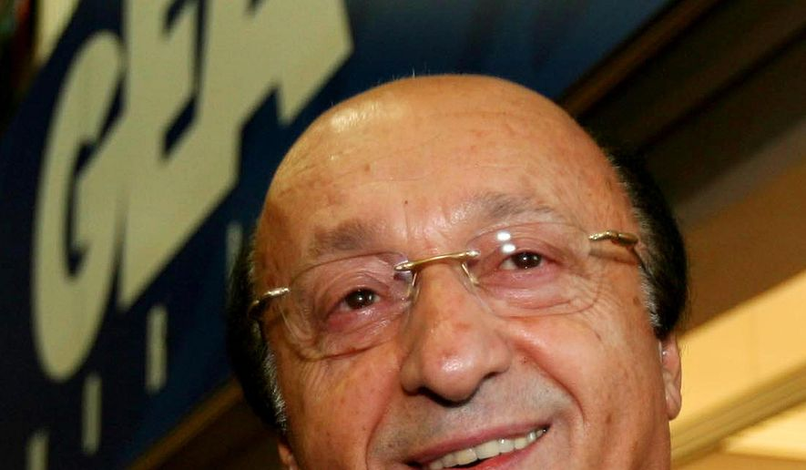 "In this March 23, 2005 file photo, former Juventus soccer club general manager Luciano Moggi arrives at the ""Lega Calcio"" headquarters in Milan, Italy. Prison sentences for former Juventus executives Luciano Moggi and Antonio Giraudo in the 2006 Italian match-fixing scandal have been eliminated after Italy's highest court dropped the charges. The Court of Cassation ruled Monday, March 23, 2015 that the statute of limitations had expired in the 9-year-old case. (AP Photo/Luca Bruno, File)"