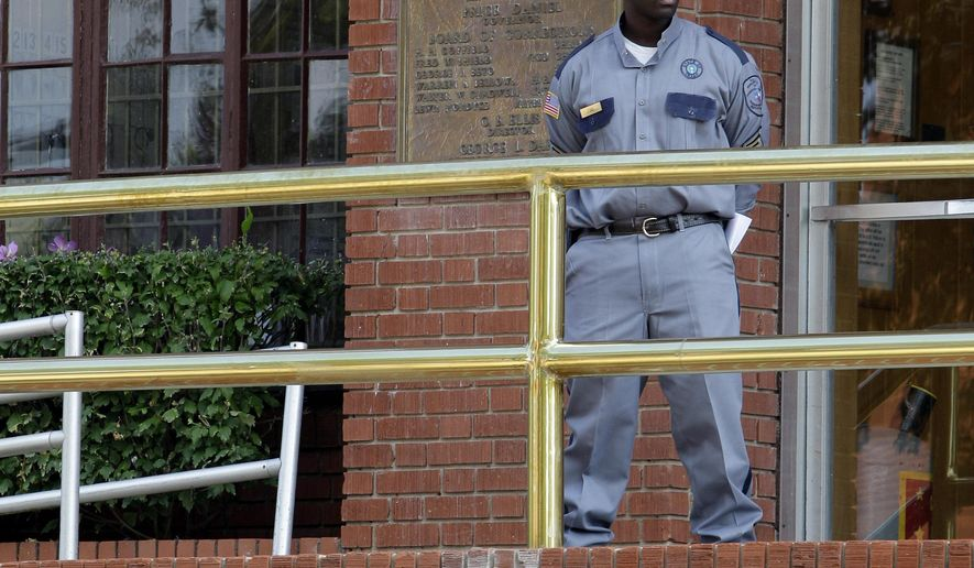 File - In this Sept. 21, 2011 file photo, a corrections officer keeps watch outside the Texas Department of Criminal Justice Huntsville Unit in Huntsville, Texas. Texas prison officials have acquired a small supply of pentobarbital to replenish their dwindling inventory of the execution drug so lethal injections set for next month in the nation's most active death penalty state can be carried out, the Texas Department of Criminal Justice said Wednesday, March 25, 2015. (AP Photo/David J. Phillip, File)