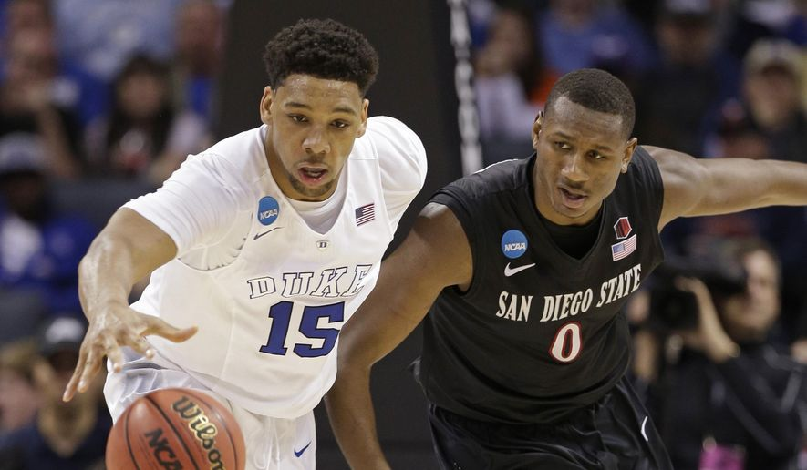 Duke's Jahlil Okafor (15) and San Diego State's Skylar Spencer (0) chase the ball during the second half of an NCAA tournament college basketball game in the Round of 32 in Charlotte, N.C., Sunday, March 22, 2015. (AP Photo/Nell Redmond)