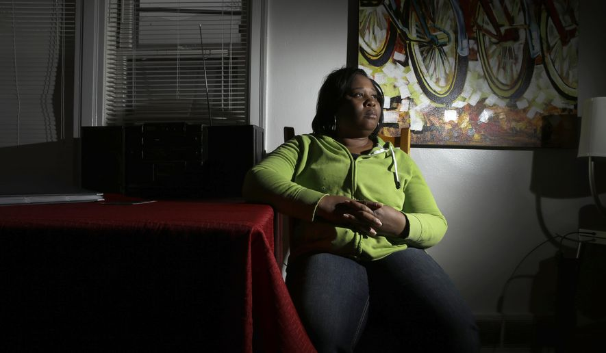 """In this Monday, Feb. 9, 2015 photo, Maria Joshua, mother of DeAndre Joshua, poses for a photo at her home in University City, Mo. Her 20-year old son was killed in the hours after the Nov. 24, 2014 announcement that a white police officer would not be indicted in the killing of 18-year-old Michael Brown. """"What I'm afraid of is the unknown, seriously, the unknown. I don't know who did this, and why. But I do want some justice,"""" she says. (AP Photo/Jeff Roberson)"""