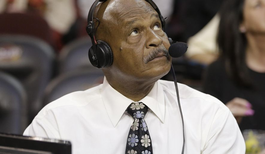 In this Wednesday, March 18, 2015, photo, Austin Carr looks up during an NBA basketball game between the Cleveland Cavaliers and the Brooklyn Nets in Cleveland. Carr never imagined his record would last five years, never mind 45. In 1970, Carr, Notre Dame's unguardable guard, dropped 61 points on Ohio, setting the NCAA tournament scoring record that has survived rule changes, tournament expansion and the madness of many a March. (AP Photo/Tony Dejak)