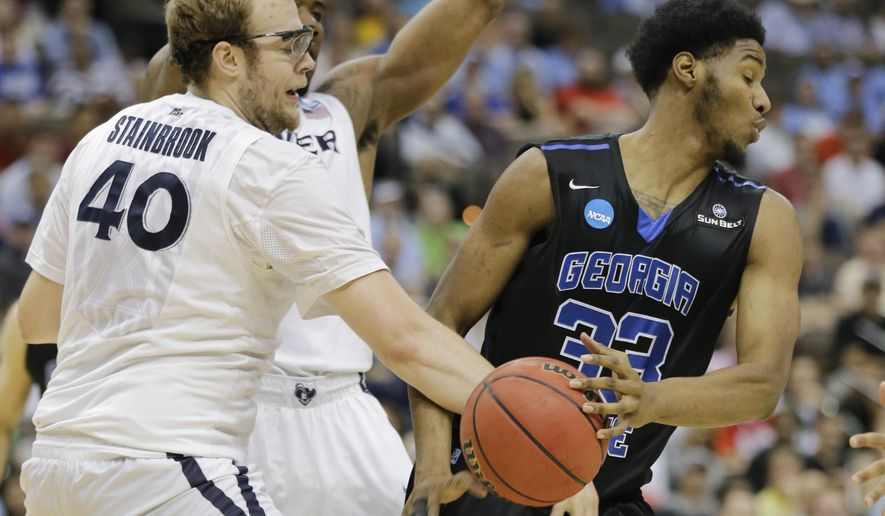 Xavier 's Matt Stainbrook (40) knocks the ball out of the hands of Georgia State's Markus Crider (33) during the first half of an NCAA tournament third round college basketball game, Saturday, March 21, 2015, in Jacksonville, Fla. (AP Photo/Chris O'Meara)