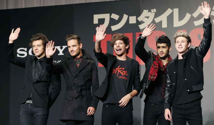 "FILE- In this March 25, 2015 file photo, members of One Direction, from left, Harry Styles, Liam Payne, Louis Tomlinson, Zayn Malik and Niall Horan, wave during an event to promote their film ""One Direction: This Is US,"" in Makuhari, near Tokyo. Malik said Wednesday, March 25, 2015, he is leaving chart-topping boy band One Direction ""to be a normal 22-year-old."" His bandmates said they were sad to see him go ""but we totally respect his decision and send him all our love for the future."" (AP Photo/Koji Sasahara, File)"