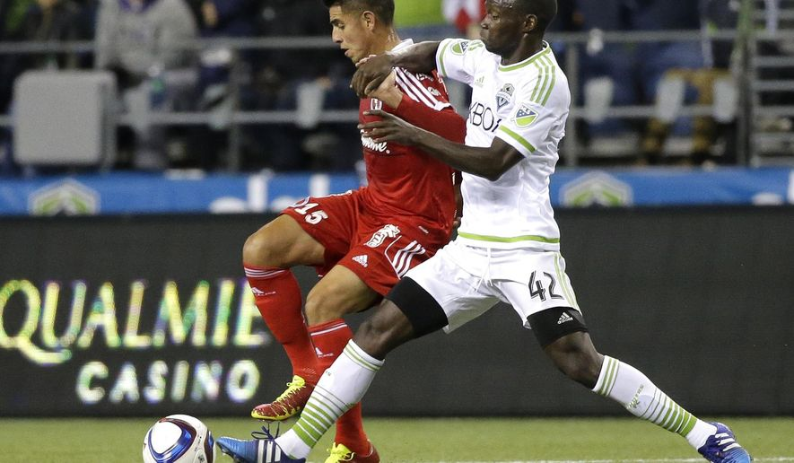 Seattle Sounders' Micheal Azira, right, challenges Club Tijuana's Joe Corona during the first half of an international friendly soccer match, Tuesday, March 24, 2015, in Seattle. (AP Photo/Ted S. Warren)