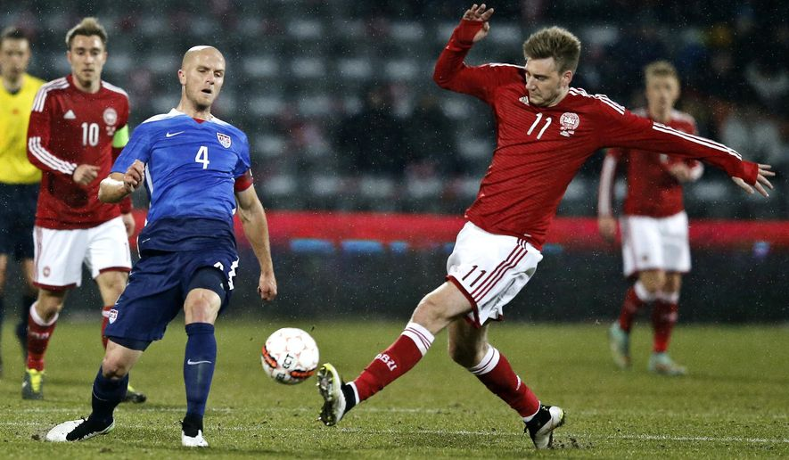 Michael Bradley from the US, left, and Nicklas Bendtner from Denmark in action during a friendly soccer match at NRGI Stadium in Aarhus, Denmark, Wednesday March 25, 2015. (AP Photo/POLFOTO, Jens Dresling)  DENMARK OUT