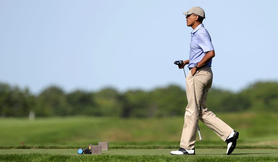 President Obama ready to tee off during a vacation round of golf; he heads to Florida this weekend for the same reason. (ASSOCIATED PRESS)