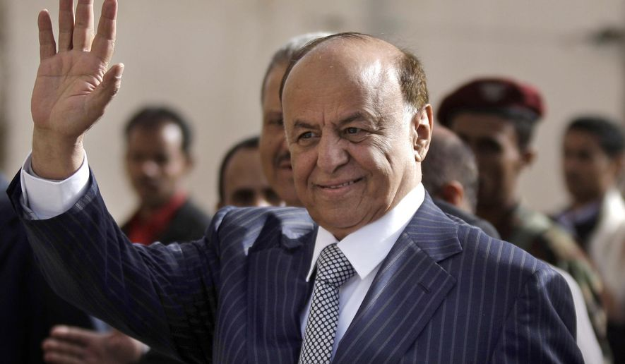 FILE - In this Tuesday, Feb. 21, 2012 file photo,Yemen's Vice President Abed Rabbo Mansour Hadi gestures as he enters a polling center to cast his vote in Sanaa. Yemen's embattled president fled his palace in Aden for an undisclosed location Wednesday as Shiite rebels offered cash bounty for his capture and arrested his defense minister. Hadi left just hours after the rebels' own television station said they seized an air base where U.S. troops and Europeans advised the country in its fight against al-Qaida militants.  (AP Photo/Hani Mohammed, File)