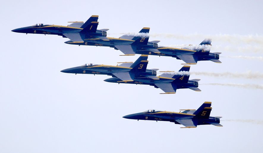 FILE - In this March 19, 2015 file photo, the U.S. Navy Blue Angels do flyover at the Arnold Palmer Invitational golf tournament in Orlando, Fla. Navy planners are in land-locked North Dakota and Minnesota to work out details for a week-long summer program that will feature the Blue Angels flight demonstration team and other promotional events. Navy Week is coming to Fargo, N.D., on July 20-26, 2105. In addition to the Blue Angels, it will include scheduled appearances by the Leap Frogs parachute team, bomb disposal teams, admirals, and the Navy Band Great Lakes. (AP Photo/Reinhold Matay, File)