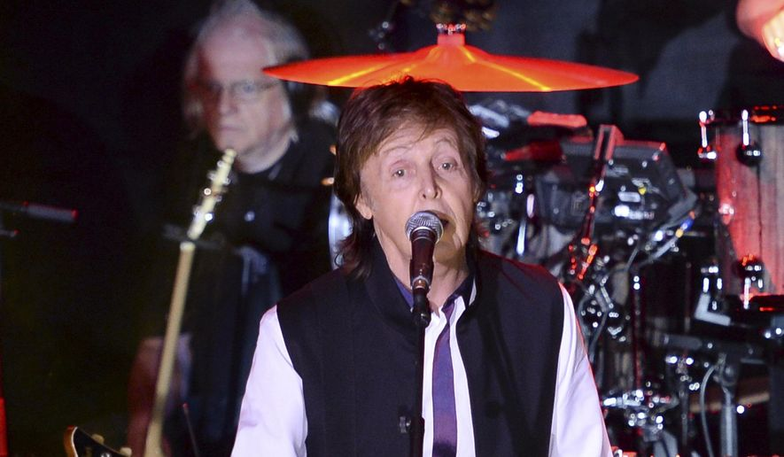 In this Feb. 14, 2015, file photo, Paul McCartney and his band perform in New York. McCartney will be among 130 acts at this year's Lollapalooza music festival in Chicago. It will be his first appearance at Lollapalooza. The festival, to take place July 31 to Aug. 2, marks its 11-year anniversary in Chicago's Grant Park. (Photo by Evan Agostini/Invision/AP)