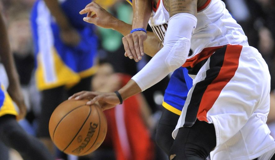 Golden State Warriors' Stephen Curry, rear, defends Portland Trail Blazers' Damian Lillard during the first half of an NBA basketball game in Portland, Ore., Tuesday, March 24, 2015. (AP Photo/Greg Wahl-Stephens)