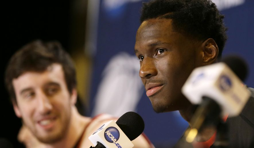 Wisconsin forward Nigel Hayes speaks during a news conference for an NCAA college basketball tournament third round game, Saturday, March 21, 2015, in Omaha, Neb. Wisconsin plays Oregon on Sunday. Teammate Frank Kaminsky, left, looks on. (AP Photo/Charlie Neibergall)