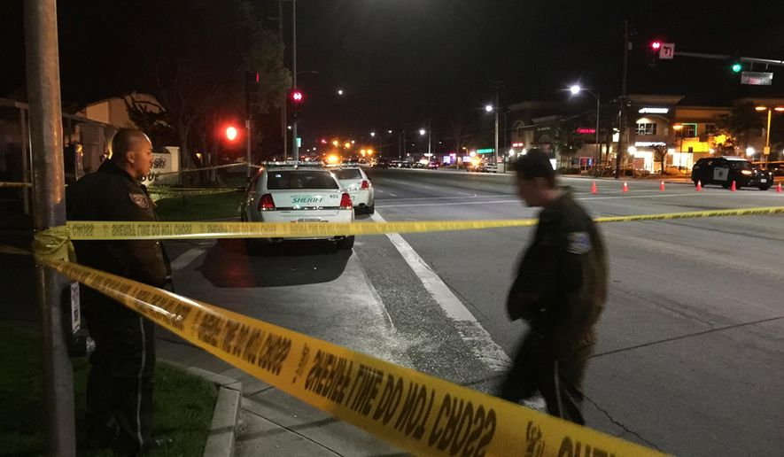 Law enforcement officers have an area blocked off as they search for a suspect in the fatal shooting of a San Jose, Calif., police officer Tuesday, March 24, 2015. Authorities say the officer was shot to death after responding to a call about a man threatening to kill himself. The San Jose Police Department says responding officers were met with gunfire Tuesday night. A veteran officer was struck and pronounced dead at the scene. (AP Photo/San Jose Mercury News, Josie Lepe)