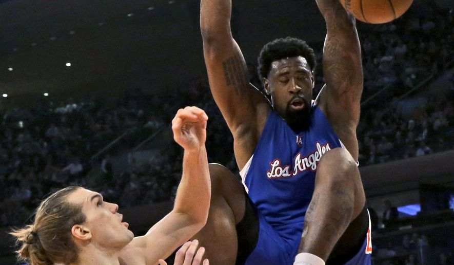 Los Angeles Clippers center DeAndre Jordan dunks in front of New York Knicks forward Lou Amundson during the first half of an NBA basketball game, Wednesday, March 25, 2015, at Madison Square Garden in New York. (AP Photo/Mary Altaffer)