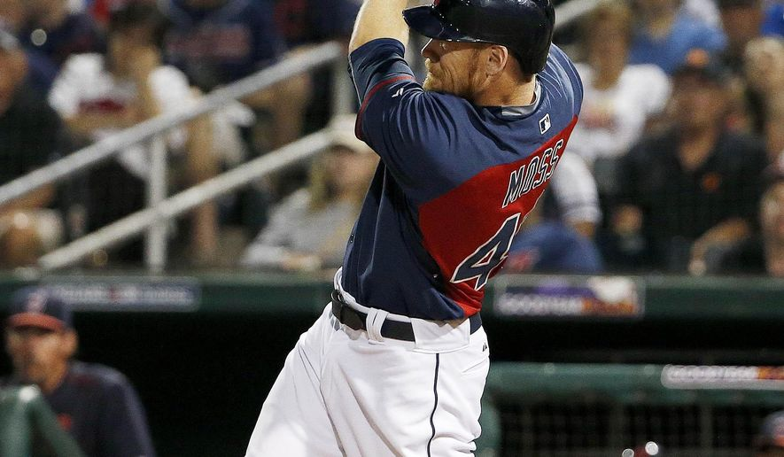 Cleveland Indians' Brandon Moss follows through on a three-run home run against the San Francisco Giants during the first inning of a spring training baseball game Tuesday, March 24, 2015, in Goodyear, Ariz. (AP Photo/Ross D. Franklin)