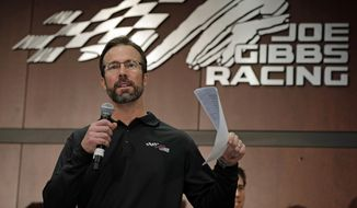 """FILE - In this Jan. 24, 2013, file photo, team president J.D. Gibbs speaks to the media during a news conference at Joe Gibbs Racing in Huntersville, N.C. Joe Gibbs Racing President J.D. Gibbs is undergoing treatment for """"symptoms impacting areas of brain function."""" The 46-year-old Gibbs is the oldest son of team owner Joe Gibbs, the Hall of Fame coach who won three Super Bowls with Washington. The team said in a statement on Wednesday, March 25, 2015,  that J.D. Gibbs has undergone a series of tests since experiencing """"speech and processing issues.""""  (AP Photo/Chuck Burton, File)"""