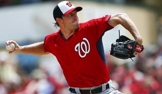 Washington Nationals starting pitcher Max Scherzer works in the first inning of an exhibition spring training baseball game against the St. Louis Cardinals, Wednesday, March 25, 2015, in Jupiter, Fla. (AP Photo/John Bazemore) **FILE**