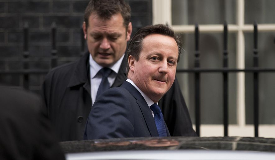 British Prime Minister David Cameron gets in a car as he leaves 10 Downing Street in London, to attend Prime Minister's Questions at the Houses of Parliament, Wednesday, March 25, 2015.  (AP Photo/Matt Dunham)
