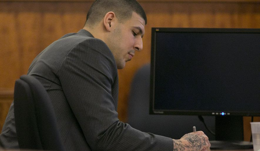 Former New England Patriots football player Aaron Hernandez takes notes during a motion regarding jail phone recordings during his murder trial at the Bristol County Superior Court in Fall River, Mass., on Wednesday, March 25, 2015.  Hernandez is accused in the June 2013 killing of Odin Lloyd.  (AP Photo/Dominick Reuter, Pool)