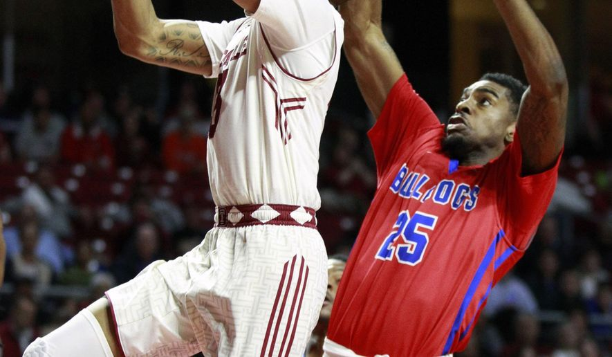 Temple's Jesse Morgan, left, goes up for a basket in front Louisiana Tech's Qiydar Davis, right, during the first half of an NCAA college basketball game in the National Invitation Tournament, Wednesday, March 25, 2015 at the Liacouras Center in Philadelphia. (AP Photo/The Philadelphia Inquirer, Charles Fox)  PHIX OUT; TV OUT; MAGS OUT; NEWARK OUT
