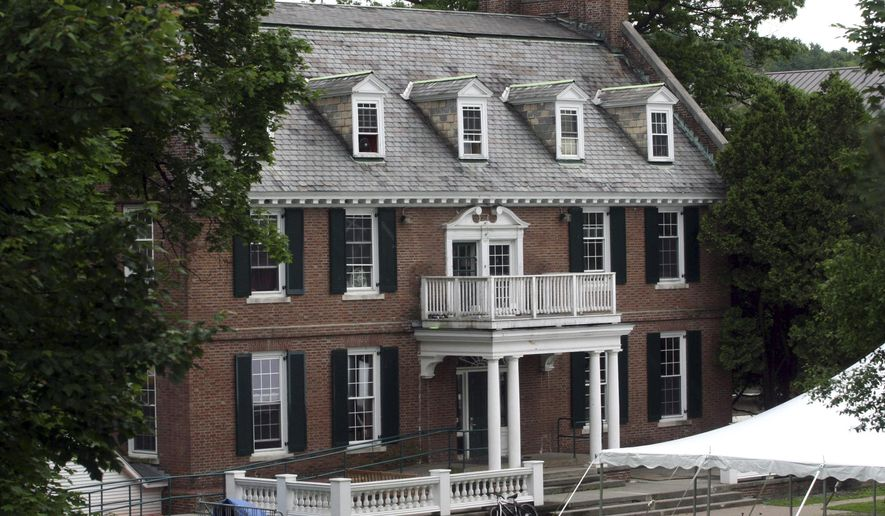 "FILE - This June 9, 2006 file photo shows the Alpha Delta fraternity at Dartmouth College in Hanover, N.H., an inspiration for the 1978 movie ""National Lampoon's Animal House."" The fraternity has been accused of branding new members while under suspension in the fall of 2014. After being on probation for most of the previous three years, the fraternity was suspended in October for hosting an unregistered party for about 70 people in August, and for a March 2014 party that featured rum, whiskey and other liquor without having a designated server or someone checking IDs. (AP Photo/Larry Crowe, File)"