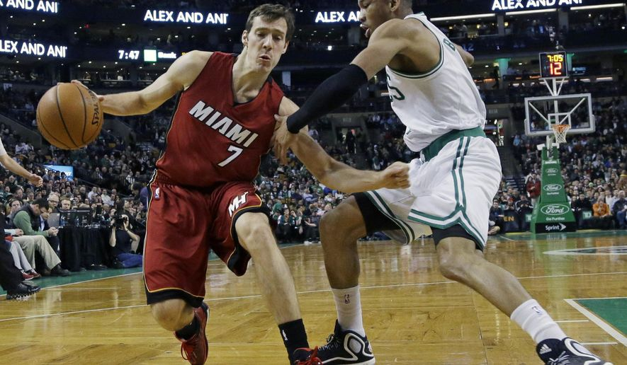 Miami Heat guard Goran Dragic (7) drives against Boston Celtics guard Avery Bradley (0) in the first half of an NBA basketball game in Boston, Wednesday, March 25, 2015. (AP Photo/Elise Amendola)