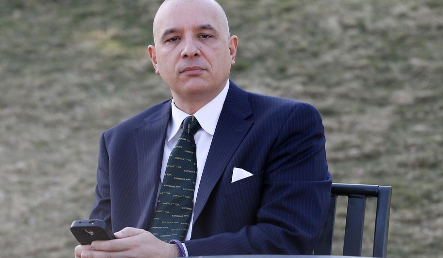 Bert Martinez poses for a photo, Tuesday, March 24, 2015, in Gilbert, Ariz. Martinez, the owner of a public relations firm in Phoenix, consulted his lawyer when one of his employees posted critical comments about him and his company on Facebook last year, but was unable to fire the employee for the criticism. (AP Photo/Matt York)
