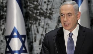 Israeli Prime Minister Benjamin Netanyahu speaks during a ceremony with Israeli President Reuven Rivlin, in Jerusalem, Wednesday, March 25, 2015.  Netanyahu struck a conciliatory tone on Wednesday as he was formally tapped to form a new government, vowing to heal rifts in Israeli society and fix ties with the United States following an acrimonious election campaign. (AP Photo/Dan Balilty)