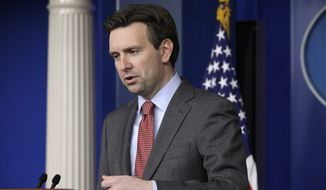 "White House spokesman Josh Earnest didn't deny that Mr. Obama voted to pass the Illinois Religious Freedom Restoration Act but said the Indiana law appears to ""legitimize discrimination."" (Associated Press)"