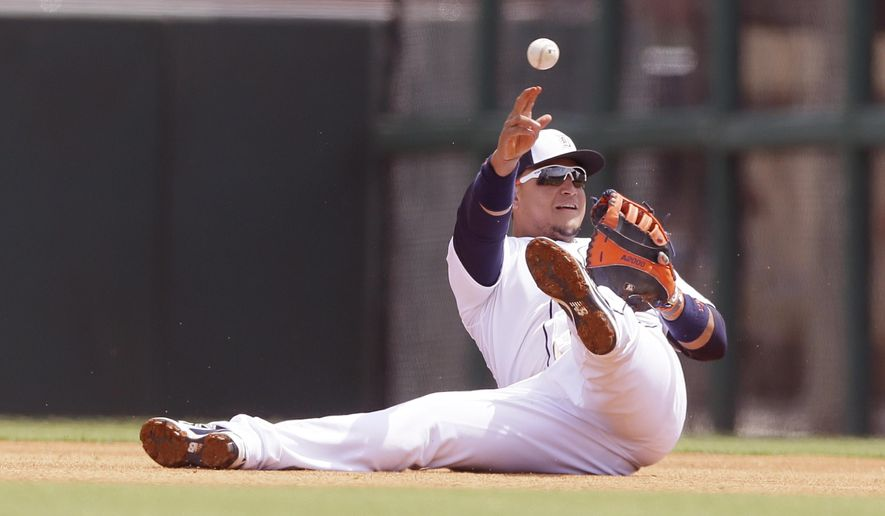 Detroit Tigers first baseman Miguel Cabrera throws to pitcher Alfredo Simon for the out on Miami Marlins' Don Kelly at first during the first inning of a spring training exhibition baseball game in Lakeland, Fla., Wednesday, March 25, 2015. (AP Photo/Carlos Osorio)