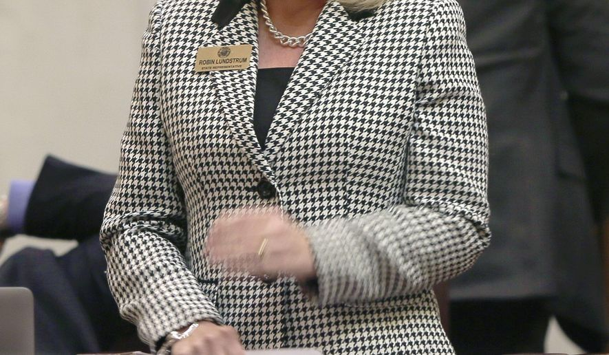 Rep. Robin Lundstrum, R-Springdale, walks to the well of the House before presenting her bill to provide for voluntary and informed consent for an abortion in the House chamber at the Arkansas state Capitol in Little Rock, Ark., Wednesday, March 25, 2015. The bill passed. (AP Photo/Danny Johnston)