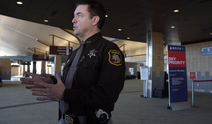 Saginaw County Sheriff William Federspiel speaks with reporters at MBS International Airport in Freeland, Mich., Tuesday, March 24, 2015.  Federspiel announced plans to increase his office's presence at the airport following an attack by a machete-wielding man at an airport in Louisiana.  The sheriff's department has a contract with the airport to provide security. He says the law enforcement presence serves as a deterrent. (AP Photo/The Saginaw News, David C Bristow ) ALL LOCAL TELEVISION OUT; LOCAL TELEVISION INTERNET OUT