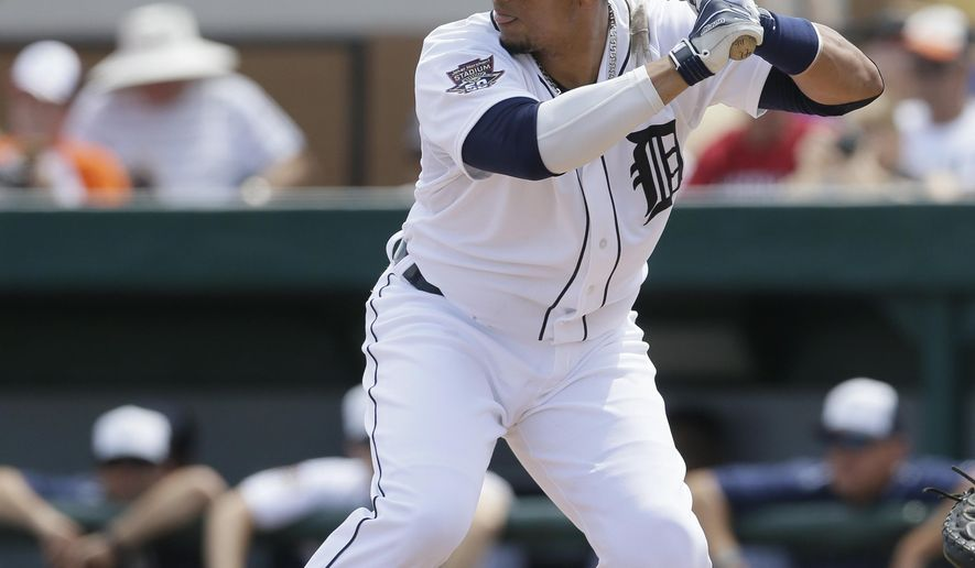 Detroit Tigers designated hitter Victor Martinez bats during the second inning of a spring training exhibition baseball game against the Miami Marlins in Lakeland, Fla., Wednesday, March 25, 2015. (AP Photo/Carlos Osorio)