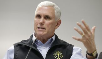 Indiana Gov. Mike Pence responds to a question during a news conference Wednesday, March 25, 2015, in Scottsburg, Ind. (AP Photo/Darron Cummings) ** FILE **