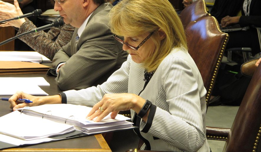 Health and Hospitals Secretary Kathy Kliebert reviews notes and financial documents before making her budget presentation to the House Appropriations Committee, Wednesday, March 25, 2015, in Baton Rouge, La. Lawmakers on the committee expressed concerns about possible cuts to health services for next year. (AP Photo/Melinda Deslatte)