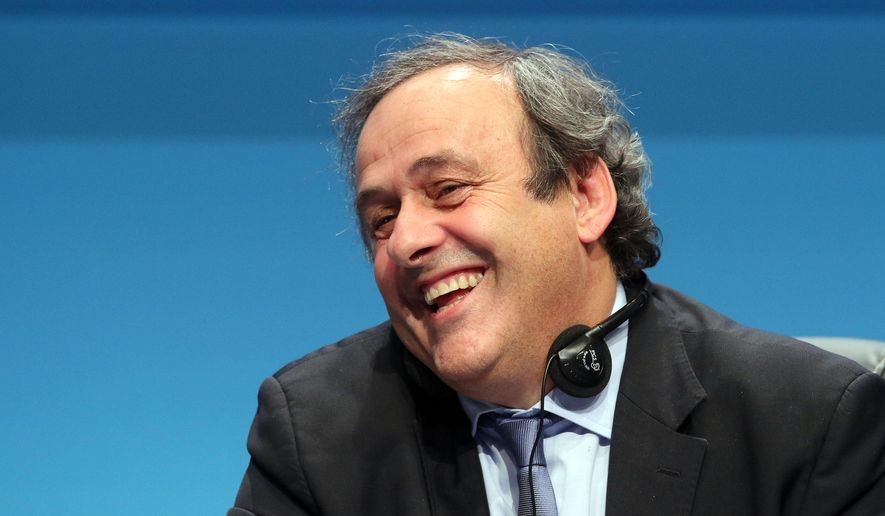 UEFA President Michel Platini laughs during a news conference at the end of the 39th Ordinary UEFA Congress in Vienna, Austria, Tuesday, March 24, 2015. Platini was re-elected as UEFA president for a third four-year term. He was unopposed to extend his presidential reign, which started in 2007, and was acclaimed by the leaders of UEFA's 54 member federations.(AP Photo/Ronald Zak)