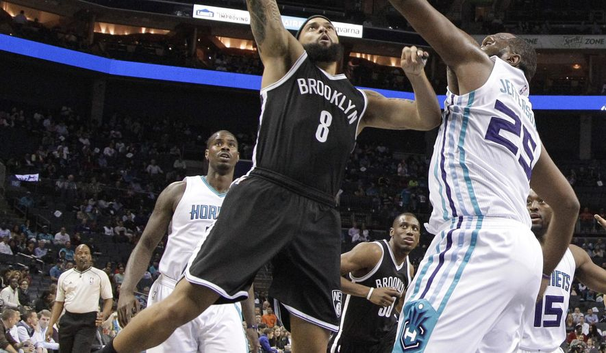 Brooklyn Nets' Deron Williams (8) shoots over Charlotte Hornets' Al Jefferson (25) during the first half of an NBA basketball game in Charlotte, N.C., Wednesday, March 25, 2015. (AP Photo/Chuck Burton)