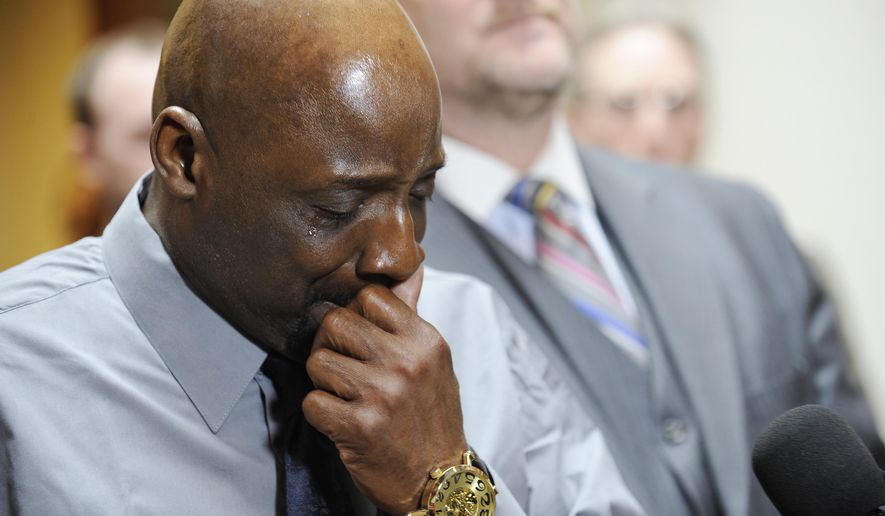 An emotional Floyd Dent tells his story about his alleged beating by Inkster police in January to members of the media, Wednesday, March 25, 2015 at his attorney's office in Novi, Mich.. His attorney Gregory J. Rohl is in the background. (AP Photo/The Detroit News, Clarence Tabb Jr.) DETROIT FREE PRESS OUT HUFFINGTON POST OUT