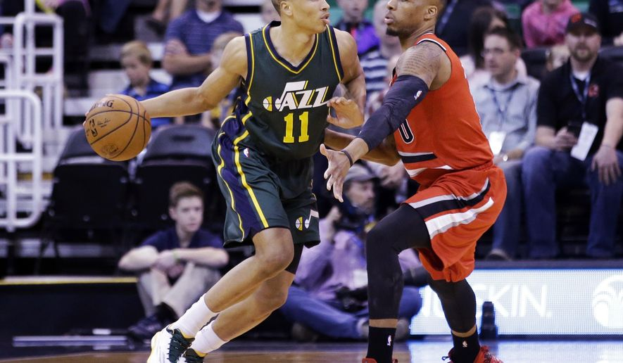 Utah Jazz guard Dante Exum (11) drives against Portland Trail Blazers guard Damian Lillard during the first quarter in an NBA basketball game Wednesday, March 25, 2015, in Salt Lake City. (AP Photo/Rick Bowmer)