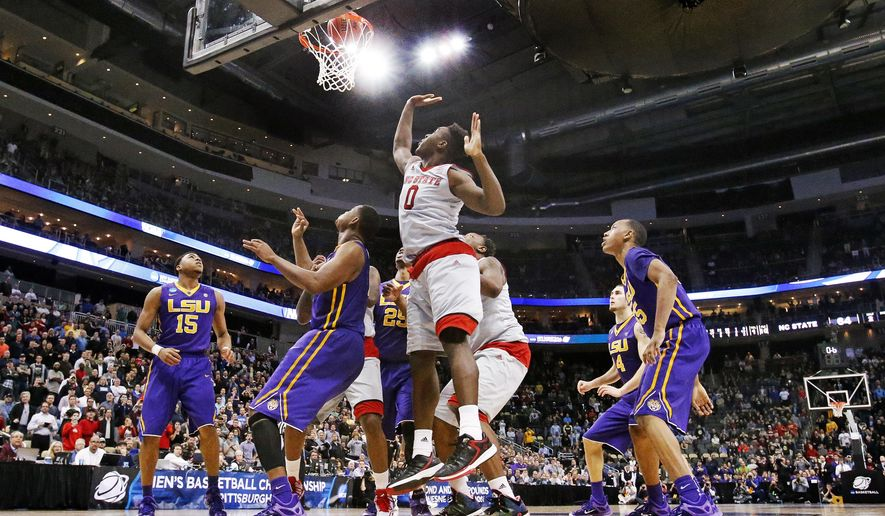 North Carolina State's Abdul-Malik Abu (0) watches the game-winning basket by teammate Beejay Anya in an NCAA college basketball second round game against LSU in Pittsburgh, Thursday, March 19, 2015. NC State won 66-65. (AP Photo/Gene J. Puskar)